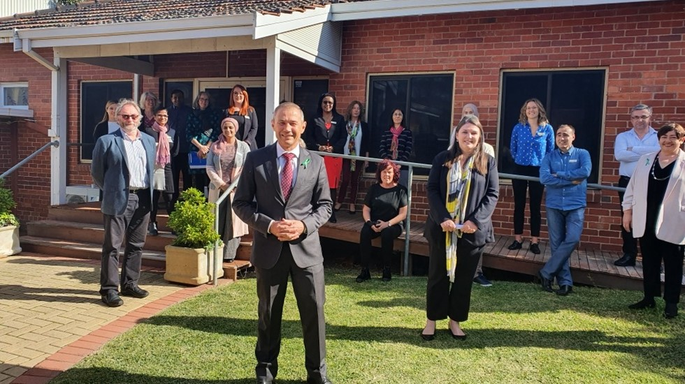 Mental Health Minister Roger Cook and the team from ASeTTs outside their Perth premises